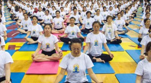 People practise yoga together ahead of World Yoga Day in Zhenjiang